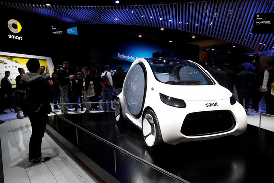 A Smart Vision EQ fortwo concept car is displayed in the Mercedes booth at the Las Vegas Convention Center during the 2018 CES in Las Vegas