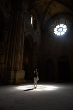 Woman standing in lights in cathedral