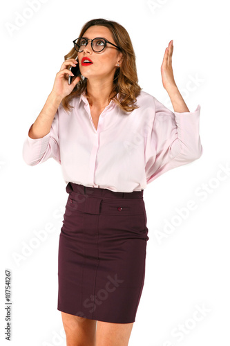 ab4b204575af1d Beautiful young business woman talking on the phone, looks indignant , with  raised up hand, dressed up in blouse, skirt, standing over white background