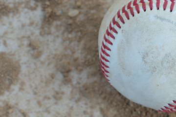Baseball sits on the home plate during America's pastime sport of baseball