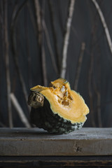 Ripe cut pumpkin on wooden table