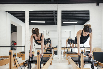 Women Doing Pilates Exercises