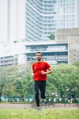 Man running in city park