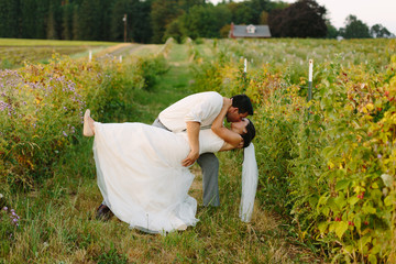 Wedding Couple Dips and Kisses at Farm