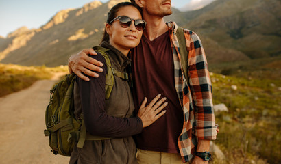 Young asian woman on hiking trip with boyfriend