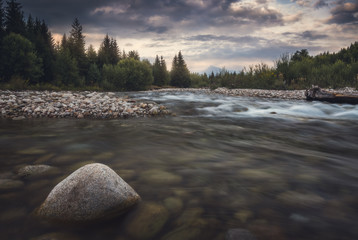 Tuinposter Rivier Bela River with Krivan Peak in Background at Sunset in Slovakia