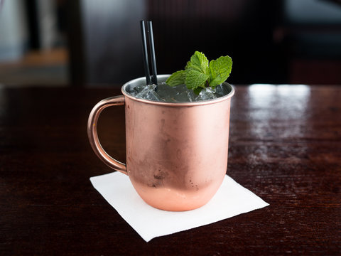 Moscow Mule on ice in traditional copper mug.