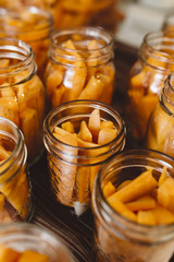Carrots and dill being preserved in mason jars