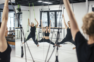 Women Doing Bodhi Suspension System Exercises
