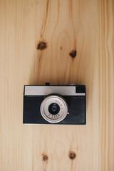 Vintage analog Soviet camera on wooden surface