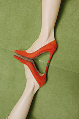 woman with red high heels