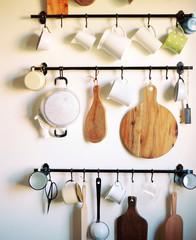 Different utensils on hooks