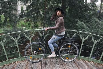 Woman riding a bicycle through park