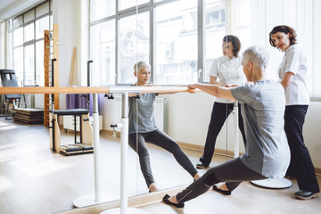 Senior Woman Doing Exercise on Barre