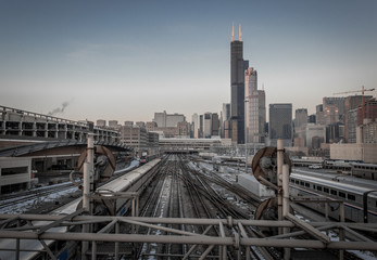 Looking down railroad tracks to the Chicago skyline