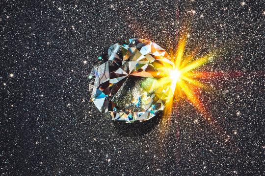 Faceted diamond reflecting burst of light