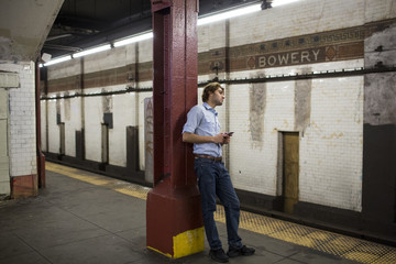A young latin man in the subway