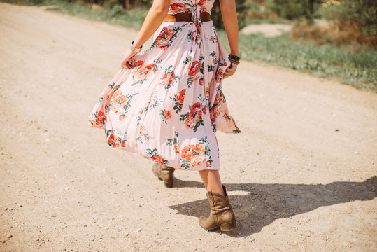 Bohemian young woman walking