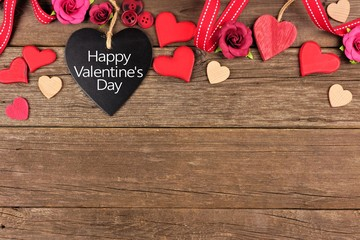Happy Valentines Day Message On A Heart Shaped Chalkboard Tag With