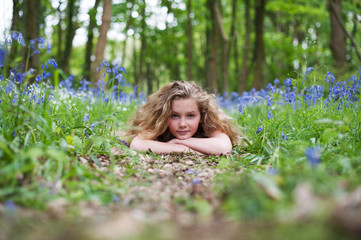 Girl laying on a woodland path
