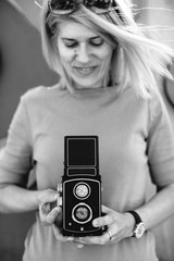 Woman with a retro 120 film camera