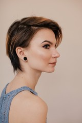Profile portrait of young female with short haircut