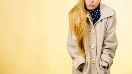 Woman wearing autumnal beige coat