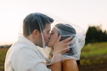 Wedding Couple Kisses at Farm