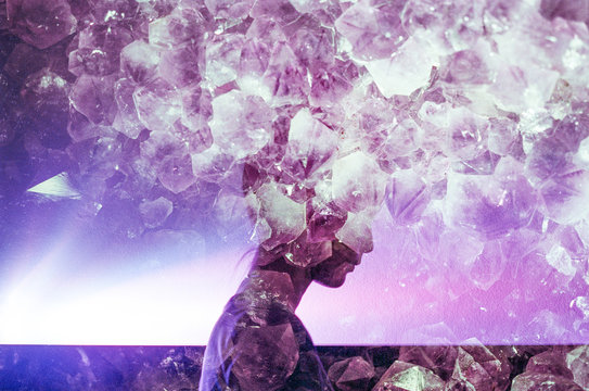 Double Exposure of woman's silhouette and amethyst crystals