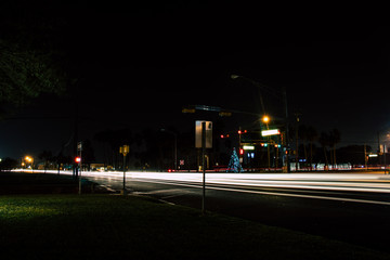 Street at night with light trails