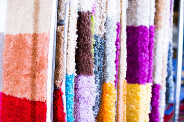 Assortment of colour carpets in the store