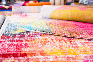 Image of traditional woolen carpets at carpet market