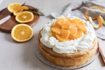 Riccota cake decorated with mascarpone cream and oranges