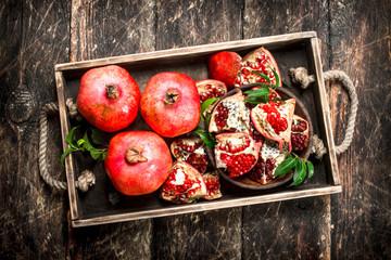 Fresh pomegranates on a tray.