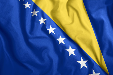 Bosnia and Herzegovina flag fluttering in the wind. Colorful national flag of Bosnia and Herzegovina. Patriotism, patriotic symbol.
