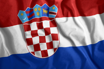 The Croatian flag is flying in the wind. Colorful national flag of Croatia. Patriotism, patriotic symbol.