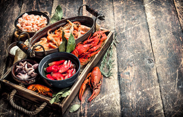 Fototapete - Different seafood in bowls.