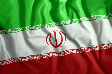 The Iranian flag is flying in the wind. Colorful national flag of Iran. Patriotism, patriotic symbol.