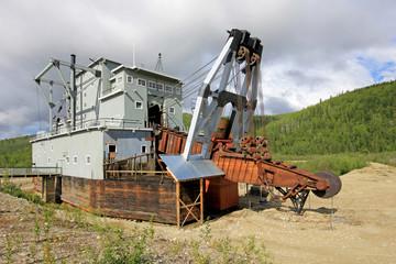 The remains of a historical delelict gold dredge on Bonanza creek near Dawson City, Yukon, Canada