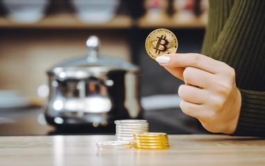 hand hold bitcoin coin