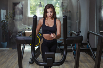 Confident woman running on treadmill