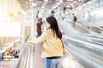 Beautiful asian woman traveling abroad carrying suitcase,luggage,baggage in airport teminal,Travel Vacation Concepts