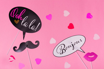 French theme photo props - lips, mustaches and hearts on pink Valentines day background