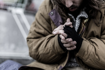Close-up of dirty beggar's hands