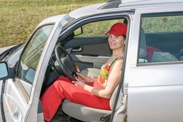 Beautiful mature woman driving a car