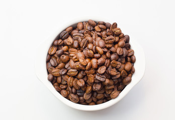 roasted coffee beans on white background space modern style.