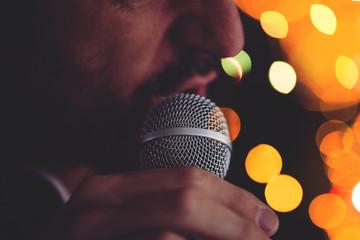 Man sings karaoke in a bar