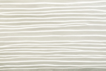 Decorative white cement wall background of abstract waves.