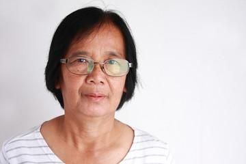 Asian elderly woman wearing glasses on white background
