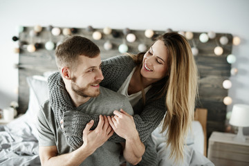 Affectionate couple having a fun at bedroom